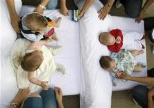 <p>Women put their babies on a mattress during traditional Corpus Christi celebrations in Castrillo de Murcia, near Burgos, northern Spain June 14, 2009. REUTERS/Felix Ordonez</p>