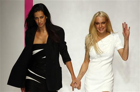 Spanish designer Estrella Archs (L) appears with Actress Lindsay Lohan at the end of her Spring/Summer 2010 collection for Emanuel Ungaro house during Paris Fashion Week October 4, 2009. REUTERS/Jacky Naegelen