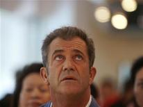 <p>Actor Mel Gibson looks up while attending a charity fundraising event in Singapore, September 13, 2007. REUTERS/Vivek Prakash</p>