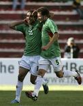 <p>Marcelo Moreno comemora gol na vitória da Bolívia por 2 x 1 sobre o Brasil neste domingo. O resultado pôs fim a uma sequência de 19 jogos sem derrota do Brasil. REUTERS/Pilar Olivares</p>