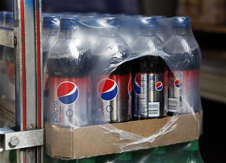 Cartons of Pepsi beverages are seen in a truck to be unloaded in New York's Hell's Kitchen neighborhood, October 8, 2009. REUTERS/Chip East