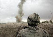 <p>A Canadian soldier of the NATO-led coalition looks at an IED (Improvised Explosive Device) exploding in the Taliban stronghold of Zhari district in Kandahar province, southern Afghanistan March 19, 2009. REUTERS/Stefano Rellandini</p>
