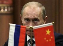 <p>Russia's Prime Minister Vladimir Putin pauses during a news conference with China's Premier Wen Jiabao after a signing ceremony at the Great Hall of the People in Beijing October 13, 2009. REUTERS/Jason Lee</p>
