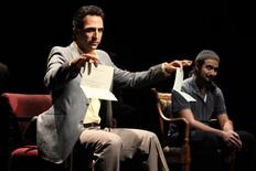 "<p>Amir Arison and Fajer Al-Kaisi perform in ""Aftermath"" at the New York Theater Workshop, in this undated handout photo. REUTERS/New York Theater Workshop/Handout</p>"