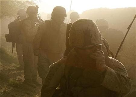 U.S. Marines leave the area where a controlled detonation of Improvised Explosive Devices (IEDs) is being carried out by sappers in the southern Helmand province October 9, 2009. REUTERS/Asmaa Waguih