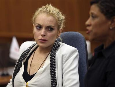 Actress Lindsay Lohan (L) and her lawyer Shawn Chapman Holley attend a progress report hearing for Lohan's 2007 drunk driving case at a courthouse in Beverly Hills, California on October 16, 2009. REUTERS/Nick Ut/Pool