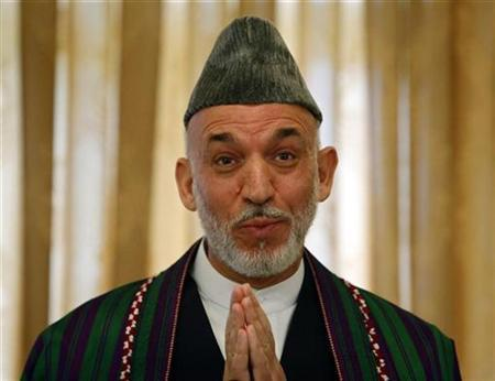 Afghan President Hamid Karzai gestures during a news conference in Kabul September 17, 2009. REUTERS/Ahmad Masood