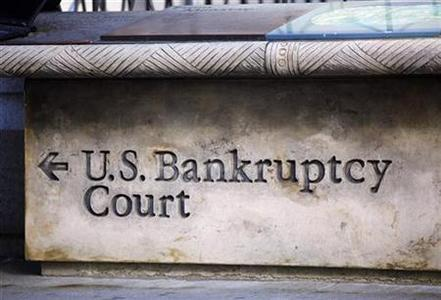 A sign points the way towards U.S. Bankruptcy Court in New York June 1, 2009. REUTERS/Chip East