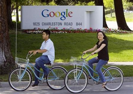 People ride their bikes past the Google headquarters in Mountain View, May 8, 2008. REUTERS/Kimberly White