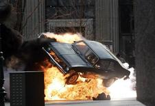 "<p>A car blows up on the set of ""Red Dawn"" in Detroit, Michigan, October 19, 2009. REUTERS/Rebecca Cook</p>"