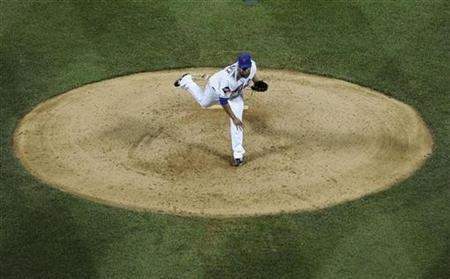 New York Mets starting pitcher Livan Hernandez follows through on a pitch in the ninth inning as he pitched the first complete game at CitiField and beat the Washington Nationals in their MLB National League baseball game in New York May 26, 2009. REUTERS/Ray Stubblebine