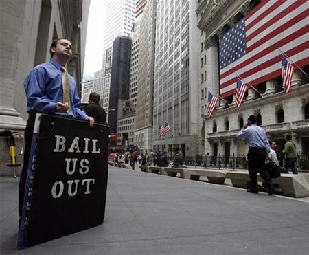 A man protests outside the New York Stock Exchange, October 13, 2008. REUTERS/Shannon Stapleton