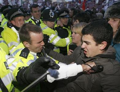 Anti British National Party (BNP) protestors clash with police during a demonstration outside BBC Television Centre in west London October 22, 2009. flagship political programme. REUTERS/Luke MacGregor
