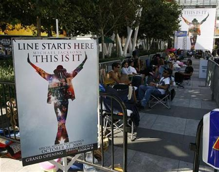 People line up and prepare to stay overnight at L.A. Live for the opportunity to purchase tickets for special showings of the ''Michael Jackson's This Is It'' movie in Los Angeles, California, September 25, 2009. REUTERS/Danny Moloshok