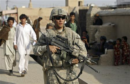 A U.S. soldier from Stryker Brigade patrols in Kandahar city October 26, 2009. REUTERS/Omar Sobhani