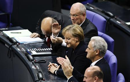 Germany's Chancellor Angela Merkel receives her applause after her election during the second meeting of the Bundestag in Berlin, October 28, 2009. REUTERS/Tobias Schwarz