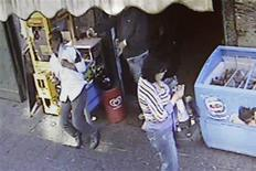 <p>A still image taken from a video released by prosecutors in Naples shows the May 11, 2009 killing of Mariano Bacio Terrasino, 53, outside a bar in central Naples. REUTERS/Procura Della Repubblica/Handout</p>