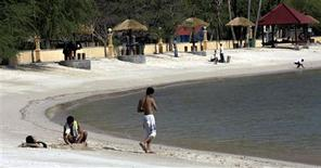 <p>Local tourists laze on a beach in Dili, East Timor September 11, 2009. East Timor's struggle against Indonesian occupation may soon become a tidy earner, with the government considering plans to promote key sites of the 25-year fight for independence as part of a tourism campaign. Picture taken September 11, 2009. REUTERS/Lirio Da Fonseca</p>