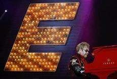 "<p>British singer Elton John performs during his show ""The Red Piano"" at the N.I.A in Birmingham, central England, November 19, 2008. REUTERS/Darren Staples</p>"