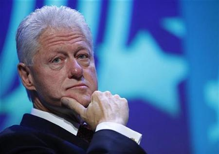 Former U.S. President Bill Clinton looks towards the audience during the Clinton Global Initiative in New York September 25, 2009. REUTERS/Chip East