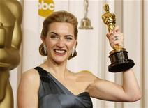 "<p>Best actress winner Kate Winslet poses with her Oscar for her role in ""The Reader"" backstage at the 81st Academy Awards in Hollywood, California, February 22, 2009. REUTERS/Mike Blake</p>"