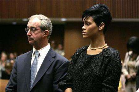 Pop star Rihanna (R) stands next to her attorney Donald Etra during a preliminary hearing at a Criminal Court in Los Angeles June 22, 2009. REUTERS/Lori Shepler/Pool