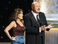 <p>Talk show host Dr. Phil McGraw (R) and wife Robin present during the 36th Annual Daytime Emmy Awards at the Orpheum Theatre in Los Angeles, August 30, 2009. REUTERS/Danny Moloshok</p>