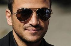 <p>Singer Peter Andre arrives at The High Court in central London July 31, 2009. REUTERS/Toby Melville</p>