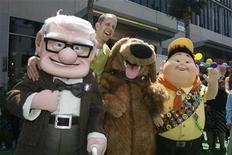 "<p>Pete Docter, director and screenwriter of the Disney-Pixar animated film ""Up"", poses with characters (L-R) Carl Fredricksen, Dug and Russell from the film during the film's premiere in Hollywood, California May 16, 2009. REUTERS/Fred Prouser</p>"