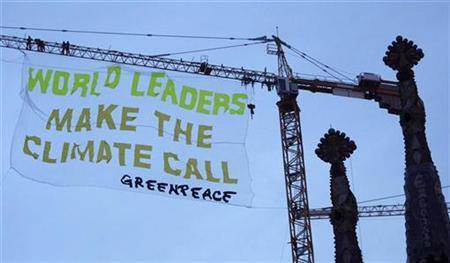 Greenpeace activists hang a banner at the Sagrada Familia Temple, designed by Antoni Gaudi, in Barcelona November 2, 2009. REUTERS/Albert Gea