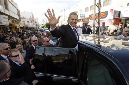 Middle East envoy and former British Prime Minister Tony Blair waves as he enter a vehicle in the West Bank city of Jenin November 10, 2009. REUTERS/Mohamad Torokman