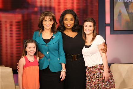 Former Alsaka Governor Sarah Palin and daughters Willow and Piper join talk show host Oprah Winfrey for a taping of ''The Oprah Winfrey Show'' in Chicago, November 11, 2009. REUTERS/George Burns/Harpo, Inc.