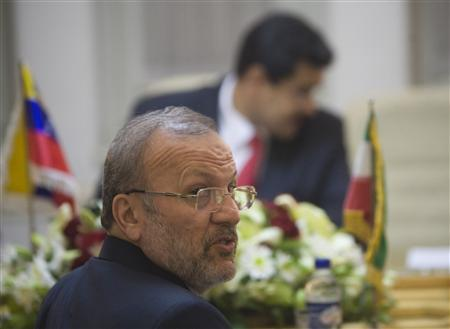 Iran's Foreign Minister Manouchehr Mottaki looks on as he attends an official meeting with his Venezuelan counterpart Nicolas Maduro in Tehran, November 17, 2009. REUTERS/Morteza Nikoubazl