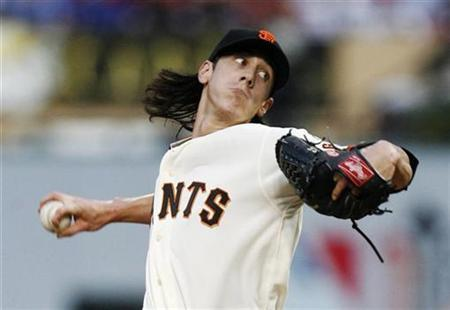 National League starting pitcher Tim Lincecum of the San Francisco Giants throws a pitch in the first inning against the American League All Stars during Major League Baseball's All-Star game in St. Louis in this July 14, 2009 file photo. REUTERS/John Gress