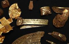 <p>A strip of gold bearing a Biblical inscription is seen amongst a hoard of Anglo-Saxon treasure named 'The Staffordshire Hoard' at the Birmingham Museum and Art gallery in Birmingham, central England in this September 24, 2009 file photo. REUTERS/ Eddie Keogh</p>