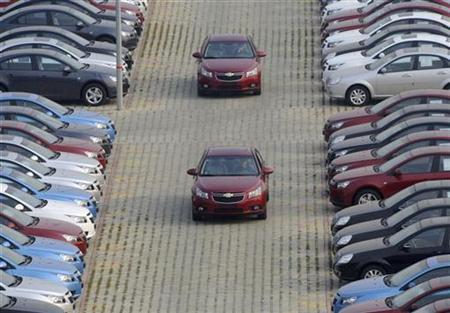 General Motors auto dealership employees drive brand new Chevrolet cars at a parking lot in Shenyang, Liaoning province, November 7, 2009. REUTERS/Sheng Li