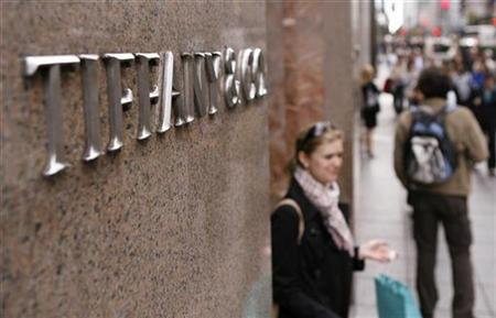 A woman walks out of the Tiffany & Co store on Fifth Avenue in New York October 8, 2009. REUTERS/Lucas Jackson