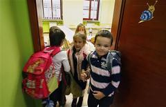 <p>Pupils leave their classroom after their lesson in a Catholic school in Sarajevo, one of seven Catholic schools that have become islands of multiculturalism in the deeply divided society of Bosnia, October 16, 2009. REUTERS/Danilo Krstanovic</p>