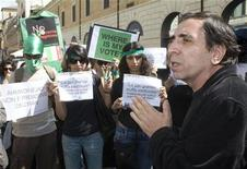 <p>Iranian film director Mohsen Makhmalbaf (R) speaks with students, who are supporters of Iranian opposition leader Mirhossein Mousavi, as they take part in a rally in downtown Rome, in support of the demonstrations in Tehran June 23, 2009. REUTERS/Alessandro Bianchi</p>