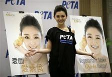 <p>Taiwanese actress Barbie Hsu poses during a news conference to unveil a new print advertisement for People for the Ethical Treatment of Animals (PETA) Asia, in Beijing November 26, 2009. REUTERS/Jason Lee</p>