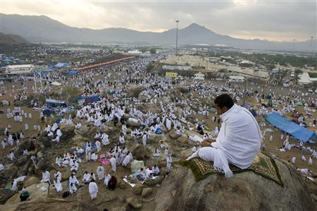A Muslim pilgrim prays on Mount Mercy on the plains of Arafat outside the holy city of Mecca, November 26, 2009. REUTERS/Caren Firouz