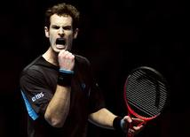 <p>O tenista escocês Andy Murray derrotou nesta quinta-feira o espanhol Fernando Verdasco na Copa do Mundo, em Londres. REUTERS/Dylan Martinez</p>