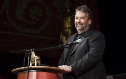 <p>French film director and producer Luc Besson gives a speech after receiving the Stockholm Visionary Award at the 20th Stockholm International Film Festival in this November 26, 2009 file photo. REUTERS/Marc Femenia/Scanpix</p>