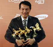 "<p>Taiwanese director Leon Dai poses with his best director, best feature film, best original screenplay and outstanding Taiwanese film of the year awards for ""No Puedo Vivir Sin Ti"" at the 46th Golden Horse Awards in Banciao, Taipei County, November 28, 2009. REUTERS/Nicky Loh</p>"