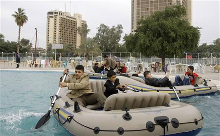 Iraqis row in boats in an open-air swimming pool in a park on Abu Nawas Street, during the Muslim festival of Eid-al-Adha, in Baghdad November 28, 2009. REUTERS/ Mohammed Ameen