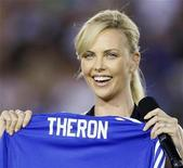 <p>Actress Charlize Theron holds up a Chelsea jersey before Chelsea's match against Inter Milan during their World Football Challenge soccer match in Pasadena, California in this July 21, 2009 file photo. REUTERS/Lucy Nicholson</p>