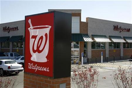 A customer drives away from the Walgreens in Westminster, Colorado October 30, 2008. REUTERS/Rick Wilking