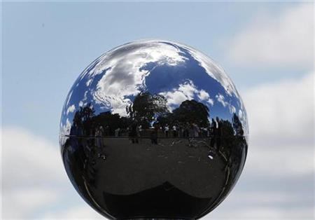 ''The People's Orb'', a 20cm (7.9 inches) silver sphere containing 350 gigabyte multimedia collected around the world to inspire action on climate change in Copenhagen, is seen in Sydney, December 2, 2009. REUTERS/Daniel Munoz