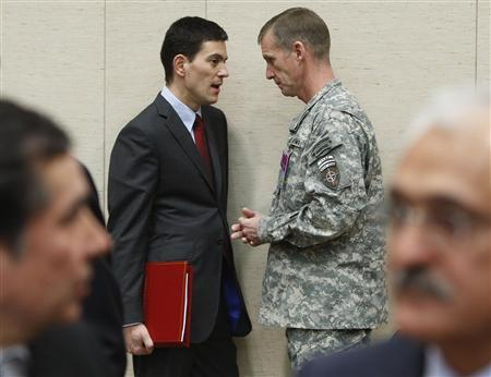 Britain's Foreign Secretary David Miliband talks to NATO commander in Afghanistan, U.S. General Stanley McChrystal, at the start of a NATO foreign ministers meeting at the Alliance headquarters in Brussels, December 4, 2009. REUTERS/Yves Herman