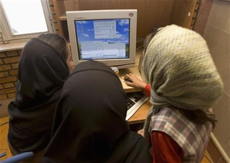 Iranian schoolgirls chat online at an internet cafe which is exclusively for females, near the city of Karaj, 60km (38 miles) west of Tehran, May 24, 2007. Iran on Saturday banned foreign media from reporting on a student rally next week that authorities fear could turn into a new round of protests against June's disputed presidential election.In the past few days, Internet connections in Tehran have been either very slow or completely down. An official at Iran's telecommunications ministry told Reuters that Internet access and cellphone lines would be disabled on Monday. REUTERS/Stringer